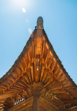 ip camera: Corner of wooden roof in Korean style with IP camera and Lens Flare concept