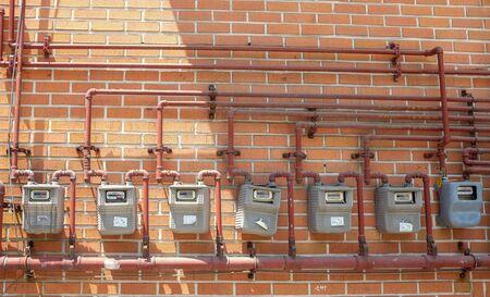 electric meter: Fila de Contador eléctrico en la pared
