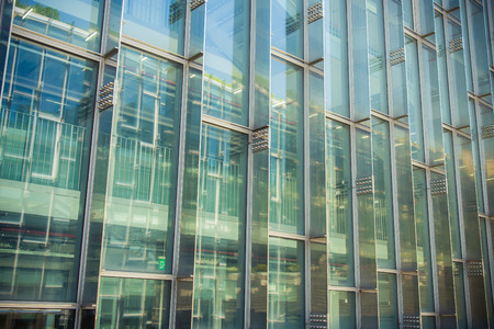 reflect: Building and reflect building on glass wall