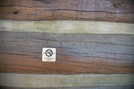 a public notice: No smoking sign on wooden wall Stock Photo