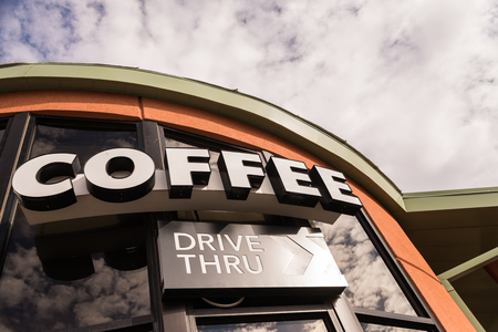 thru: Coffee drive thru sign with cloudy sky