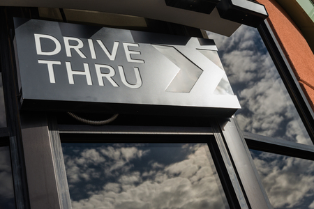 thru: Coffee drive thru sign with reflect from glass window Stock Photo