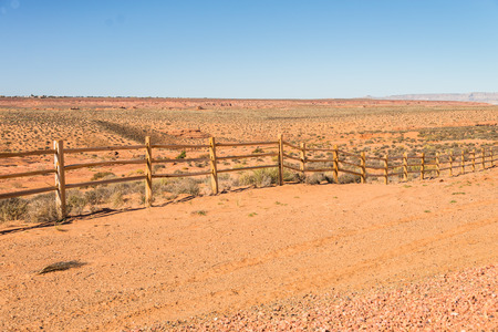 cattle wire wires: Old wooden fence in countryside of desert