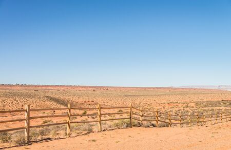 cattle wire: Old wooden fence in countryside of desert