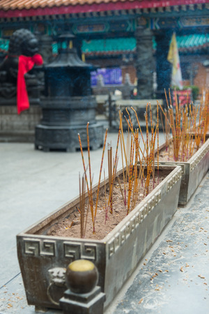 joss: Burning joss stick put in chinese pot of temple