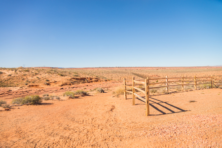cattle wire wire: Old wooden fence in the sandy desert Stock Photo