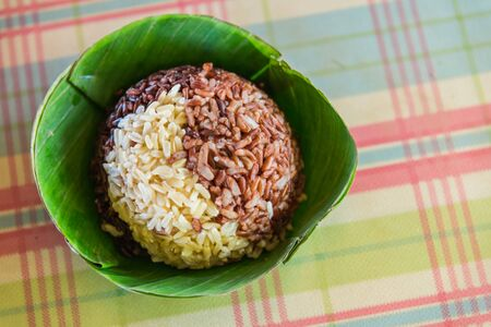 two tone: Two tone steamed rice in Banana bowl Stock Photo