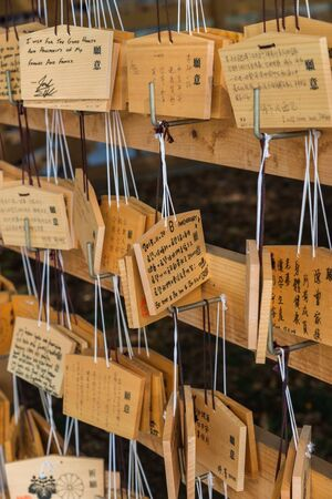 buddhism prayer belief: Lot of Wooden Wishing Plaques at Ueno shrine Tokyo