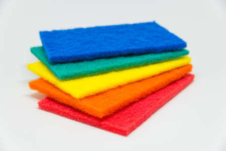 scour: Colorful Scouring pad with white background and selective focus