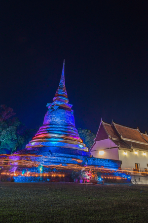 rite: Triple Circumambulation around old pagoda of Trapangtong Temple in Sukothai Thailand Stock Photo