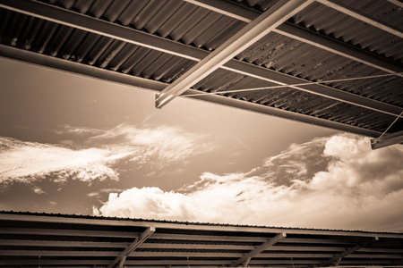 blue grey coat: Beautiful sky with cloudy between Metal sheet roof in Sepia style Stock Photo
