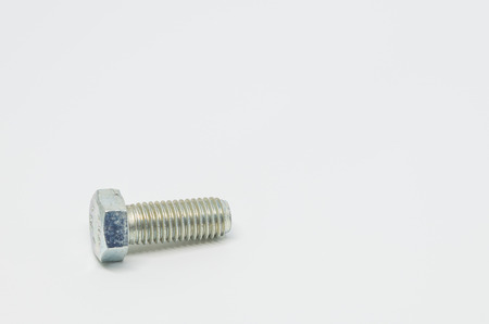 Stainless steel bolt on white background and selective focus Stock Photo