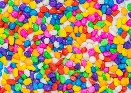 gravel: Colorful stone pattern on white background and selective focus