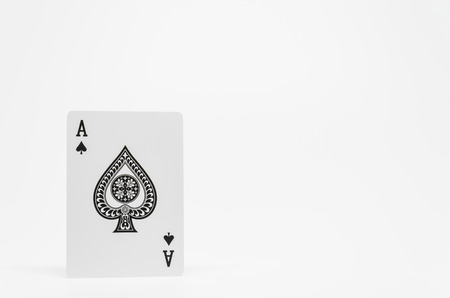 Black Spade Ace card on white background and selective focus Stock Photo