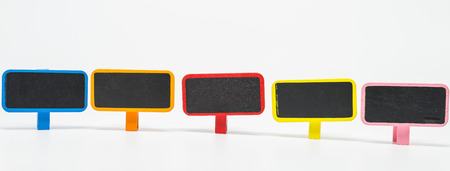 Colorful wooden black board with clip on white background and selective focus