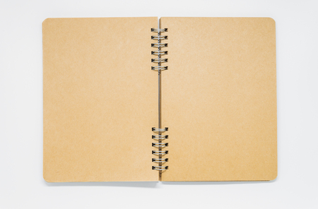 Opened Brown plain notebook with ring on white background and selective focus