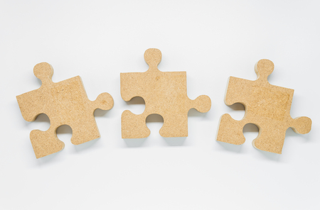 Three pieces of wooden puzzle on white background