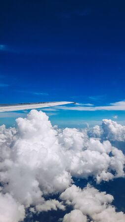 Beautiful blue sky with cloud and airplane wing