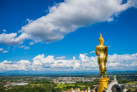 Stand Buddha statue with city view in Wat Phra That Kao Noi Nan Thailand Banque d'images