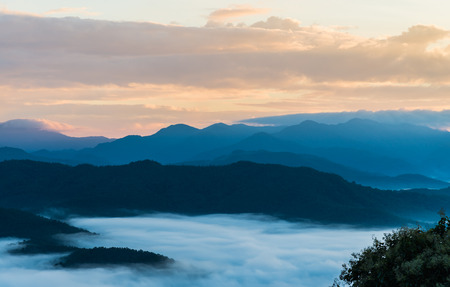 Beautiful Sea of mist in the morning with layer of mountain and sunrise scene