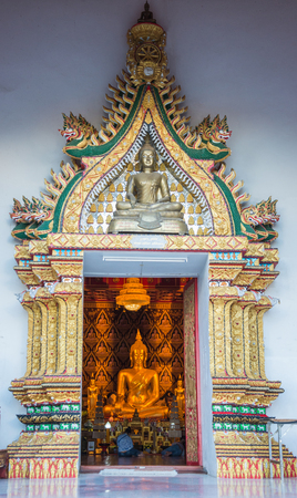 Golden sitted Buddha statue in Wat Suan Tan which was built in 1230 and have beautiful shape of Pagoda in Nan Province Thailand