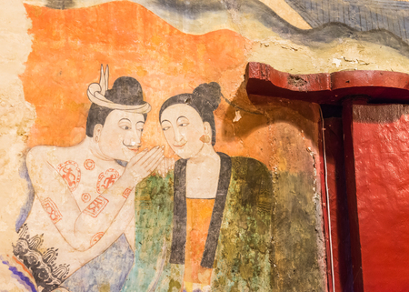 Famous ancient wall murals called Pu Man and Ya Man in Wat Phumin Nan Thailand