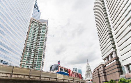 BTS Skytrain run on track through downtown of Bangkok Thailand