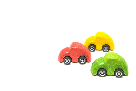 Isolated Colorful wooden car toy in race on white background Banque d'images