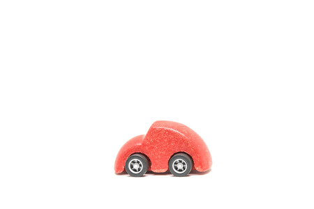 Isolated Red wooden car toy on white background Banque d'images