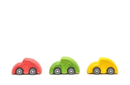 Isolated Colorful wooden car toys in row sequence on white background