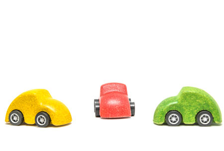 Isolated Colorful wooden car toys on white background Banque d'images