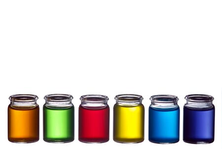 Line of glasses filled with colorful liquid isolated on white Stock Photo - 6039443