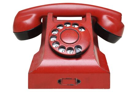 Red retro telephone isolated in white background photo