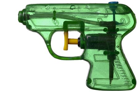 Green transparent plastic water pistol isolated on a white background photo