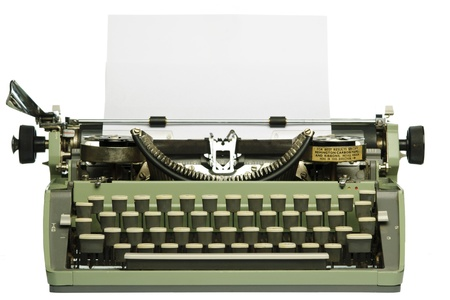 Retro typewriter with blank paper isolated on white background photo
