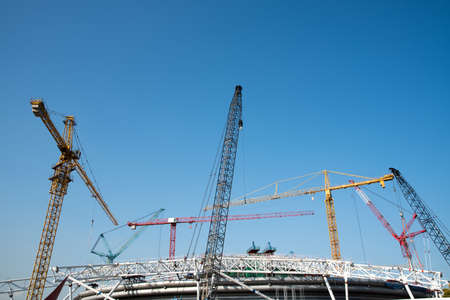 tower cranes on a background of blue sky
