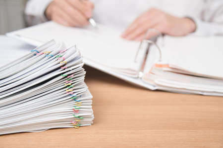A pile of documents with the man in the document Foto de archivo