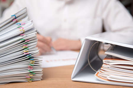 A pile of documents with the man in the document Stock Photo