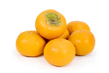 Fresh sweet persimmon fruit isolated on white background. 스톡 콘텐츠