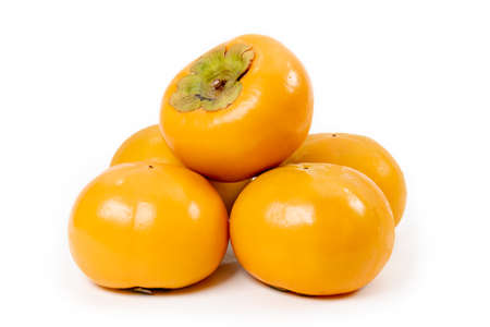 Fresh sweet persimmon fruit isolated on white background. 스톡 콘텐츠