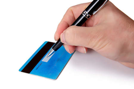 Businessmans hand signing the back of his credit card. Imagens