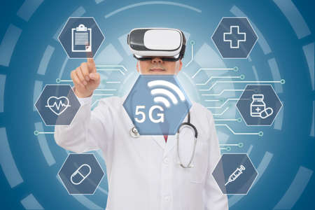 Male doctor wearing virtual reality glasses. 5G Medical Concept. CG Фото со стока