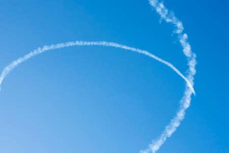 Airplane trails on blue sky with copy space Stok Fotoğraf