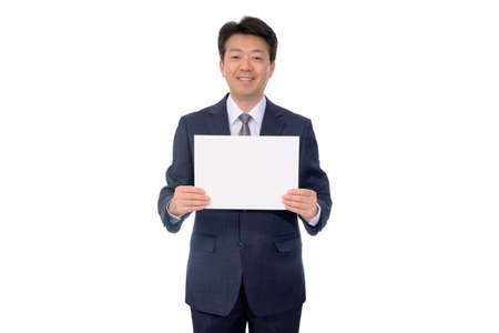 Portrait of Asian businessman holding blank message board.