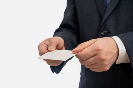 Businessman showing blank business card isolated on white background. Business concepts.