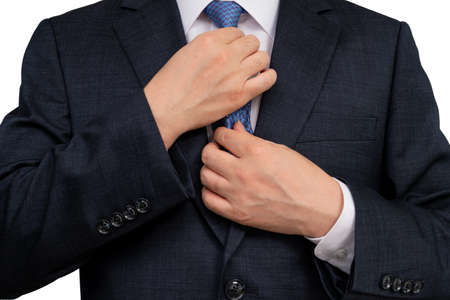 The upper body of a man businessman in a suit on a white background. Stockfoto