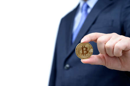 Golden Bitcoin in a mans hand. blockchain and new virtual currency.