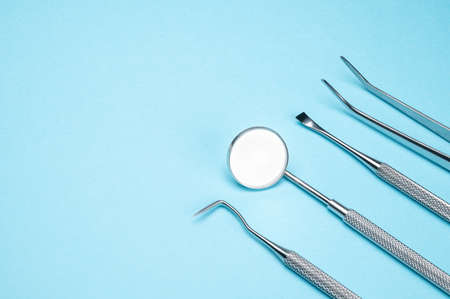 Dental tools on blue background. Medical technology concept. Dental hygiene. Cure concept. Dentist tools. Dental equipment. Zdjęcie Seryjne