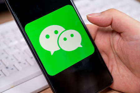 Seoul, South Korea - July 2020: WeChat application icon on smartphone screen close-up. 免版税图像 - 152968956