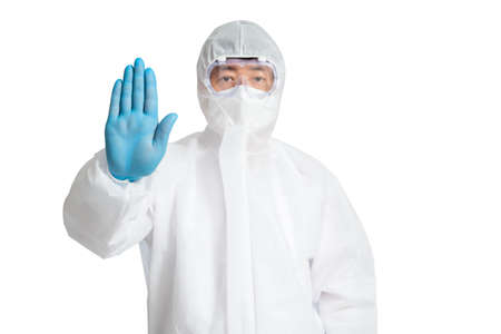 An Asian man wearing a protective suit, protective face masks, and safety glasses on a white background. 免版税图像